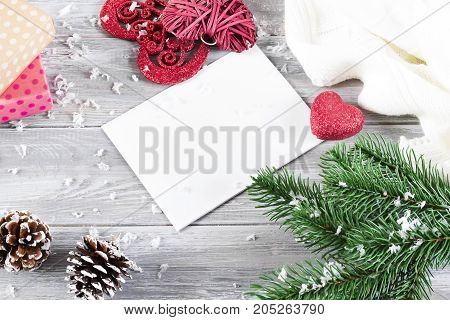 Christmas flat lay styled scene with evergreen tree twigs Christmas decorations on a gray concrete background and copy space
