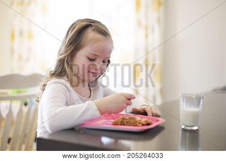 A Beautiful girl drinking milk and eating dessert