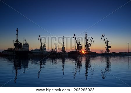 Lots of cargo cranes in the dock of Industrial Port