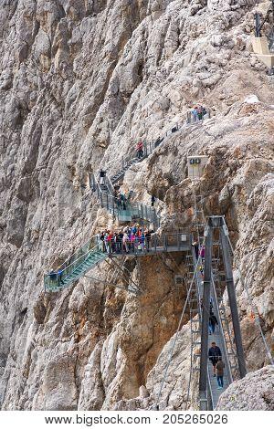 Ramsau Am Dachstein, Austria - August 17: Tourists Walk On The Austrias Highest Suspension Bridge Da