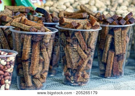 Brown dry rusks in plastic glasses on a table