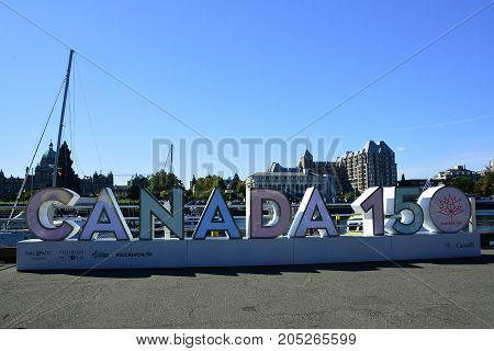 Victoria BC,Canada,September 22nd 2017.The 150 sign celebrating Canada's 150 years of being a country sits at the inner harbor in Victoria BC.with the parliament buildings and hotels in the background,Come explore Victoria.
