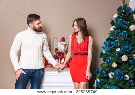 Beautiful Young Couple Is Celebrating Christmas At Home.