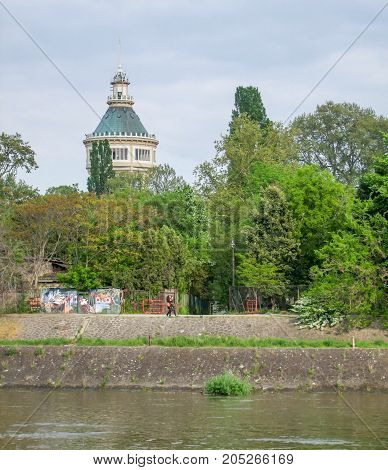 waterside scenery at Danube river with historic water tower seen in Budapest Hungary