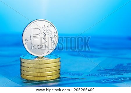 Russian ruble on a pile of coins.