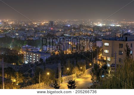 Fars Province Shiraz Iran - 19 april 2017: View from top point on the night lights of the Iranian city.