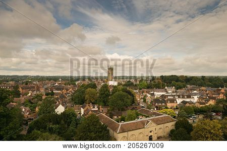 Warwick, United Kingdom - September 19, 2016: View of the Medieval castle tower and gatehouse from within the castle gardens and people enjoying the setting, Warwick, Warwickshire