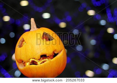 Pumpkin with burning eyes on Halloween with blue background bokeh