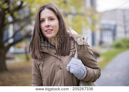 A Portrait Of Female University Student Outdoors On Campus