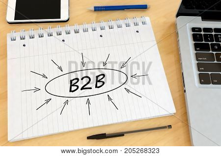 B2B - Business to Business - handwritten text in a notebook on a desk -