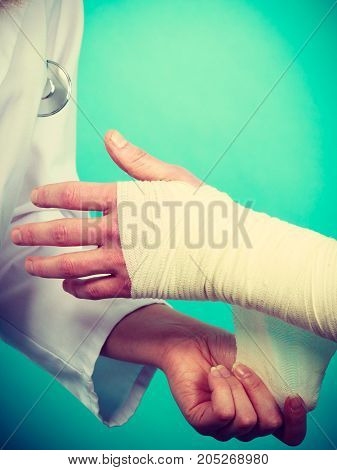Doctor Bandaging Sprained Wrist.