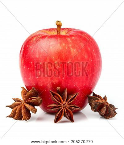 Fresh red apple with star anise isolated on white background.