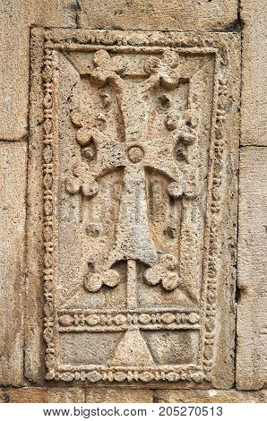 Khachkar - ancient armenian cross-stone in monastery Geghard