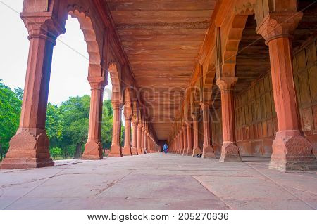 Agra, India - September 20, 2017: Beautiful view of a stoned path with columns in a row inside of a building at outdoors in the Indian city of Agra, India, fish eye effect.