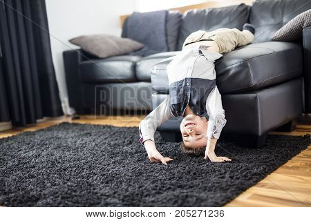 A Young Boy Relaxing On Sofa At Home