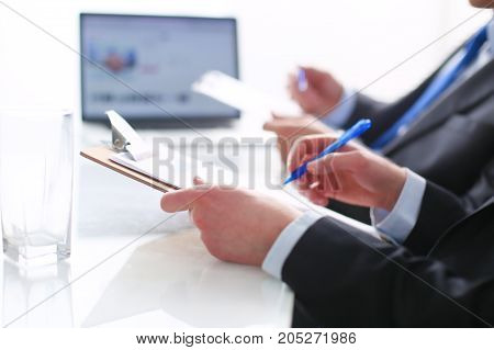 Businesspeople sitting on the desk on office . Businesspeople.