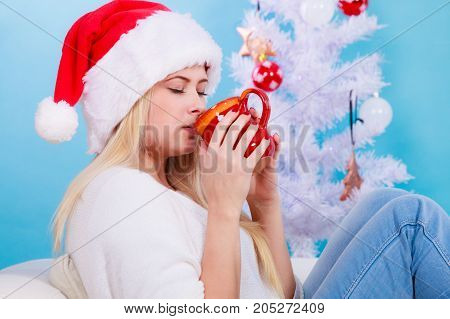 Woman In Santa Christmas Hat Drinking Tea Or Coffee