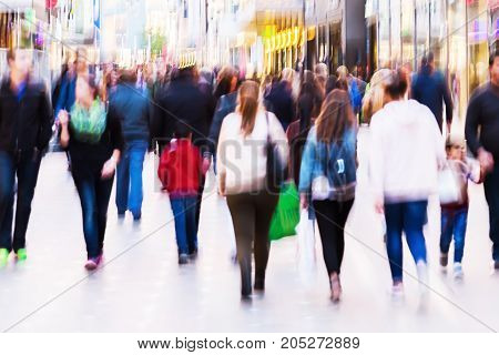 crowds of people in the shopping street with camera made blur effect