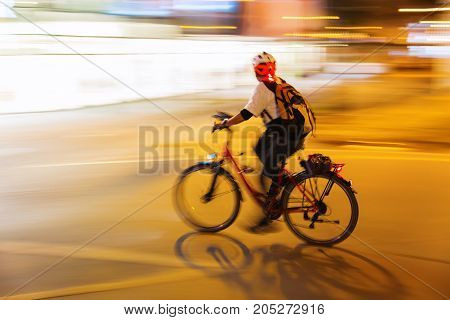 Bicycle Rider At Night In The City