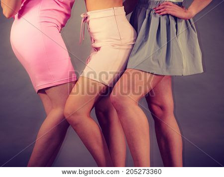 Unrecognizable Women Presenting Outfit