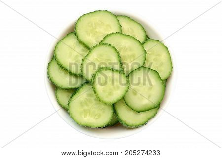 Bowl with cucumber slices isolated on white background. Top view