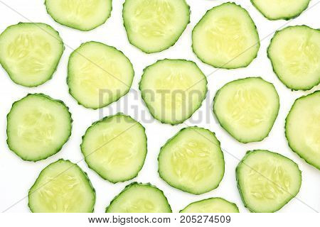 Background concept with cucumber slices on white