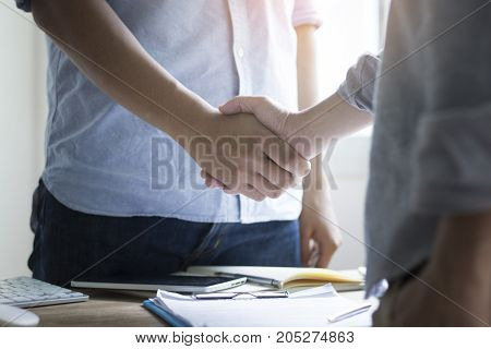businessman shaking hand and city concept as team work and cooperation in success business