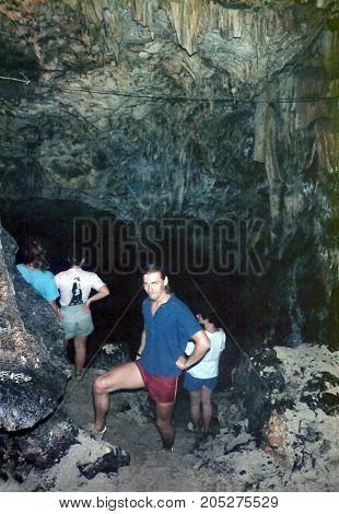 TONGATAPU / TONGA - CIRCA 1990: Spelunkers explore a limestone cave on the east side of the island of Tongatapu.
