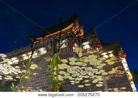 Lijiang Artistic Chinese Gate Water Reflection