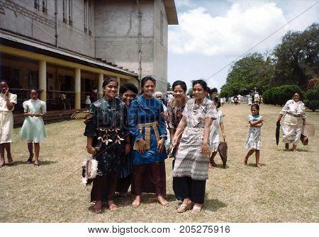 NUKU'ALOFA, TONGATAPU / TONGA - CIRCA 1990: Tongan ladies, in their Sunday finery, pose for a photograph outside the Centenary Wesleyan Methodist Church, after a worship service.