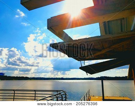 A lake view from a boat shack on a sunny day.