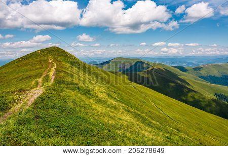 Path Through Grassy Meadow On Hillside In Summer