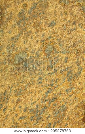 Natural yellow patterned slate surface for background