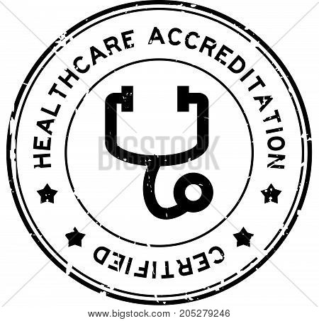 Grunge black healthcare accreditation with stethoscope icon round rubber seal stamp on white background