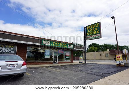 JOLIET, ILLINOIS / UNITED STATES - JULY 24, 2017:  One may obtain an auto title loan at the Payday Loan Store, in a strip mall on Plainfield Road.