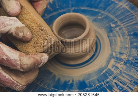 Potter From The Clay Pitcher On A Potter's Wheel.