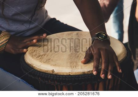 An African Or Latin Brown Djembe Conga Drum Being Played Against