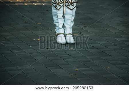 Close Up Picture Of A Woman's Boots On The Alleway