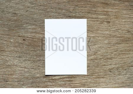 White color paper attach on wood background for remind or memo