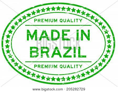 Grunge green premium quality made in Brazil oval rubber seal stamp on white background