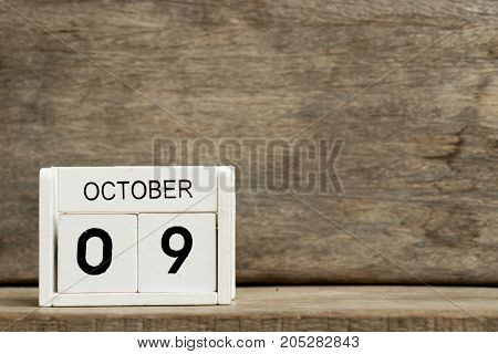 White block calendar present date 9 and month October on wood background (Day of fire prevention hangul in south korea)