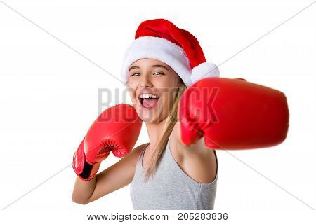 sporty happy young girl wearing christmas santa hat with fighting gloves isolated xmas and boxing day concept