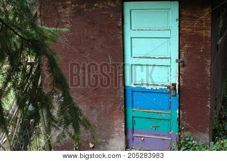Colorful caribbean door displayed on an island outdoors.