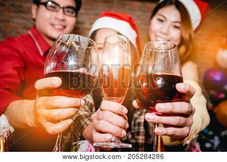 Asians people are together to celebrate the Christmas and Happy New Year party.
