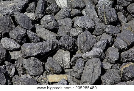 Many pieces of fossil coal, like a background