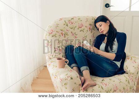 Depression Girl Having Problem Sitting On Sofa