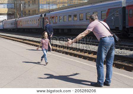 Long-awaited joyful meeting on the platform of the railway station