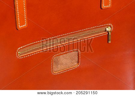 Closeup of brown leather briefcase with brass buckle. High resolution photo.