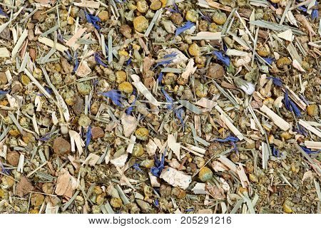 Tea mix of chamomile, thyme, cornflowers, mate lemongrass and ginger. High resolution photo.
