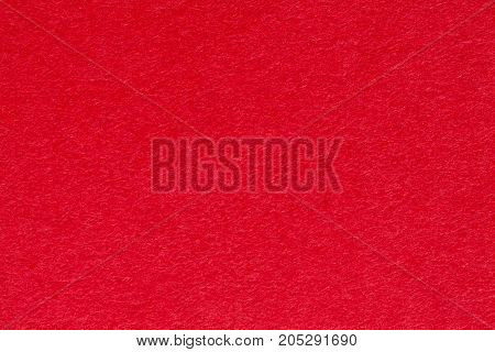 Bright red paper background, good for decorations and craft. High resolution photo.